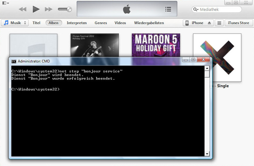 Screenshot of iTunes and the CMD window